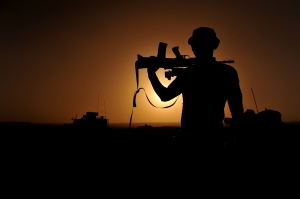 Soldier Silhouetted in Afghanistan