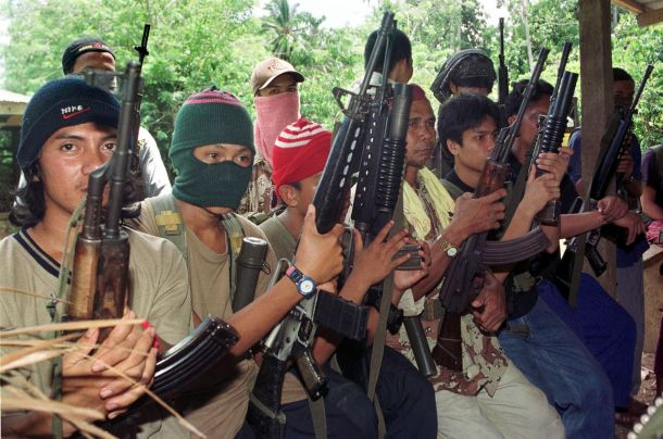 Abu Sayyaf gunmen displaying their weapons in the jungles of the Philippines in 2000. Photo: AFP