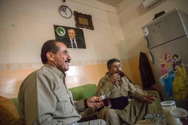 Retired liwa Saleh laughs with his old comrades about the things they did in previous wars, including fighting the forces of Saddam Hussein.